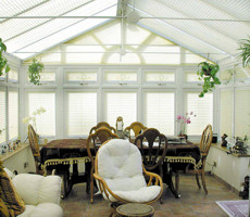 Gable end conservatory with blinds