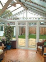 Gable end conservatory with decorative glass