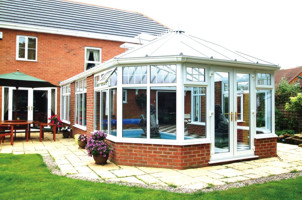 Long victorian conservatory with pool